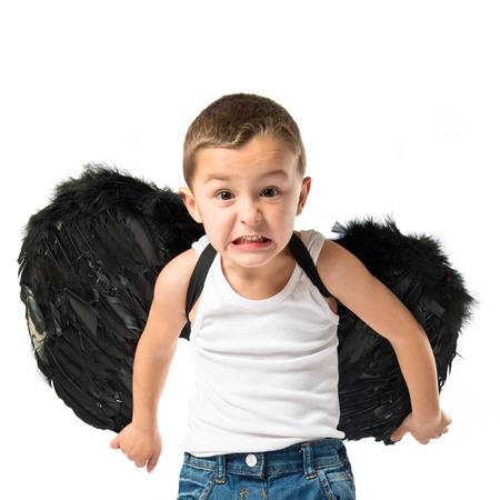 angry angel: Kid with black wings over white background