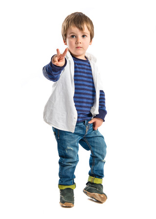 Boys making a victory sign over white background  photo