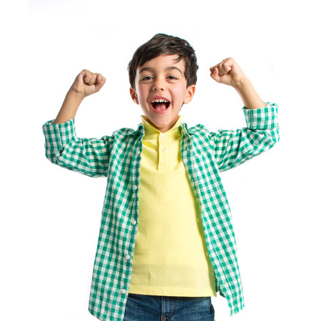 excited man: Lucky brunette kid over isolated white background  Stock Photo