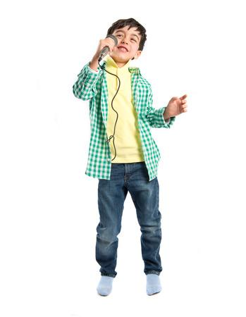 Kid singing over white background