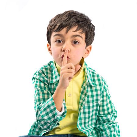 Kid doing silence gesture over white background  Standard-Bild