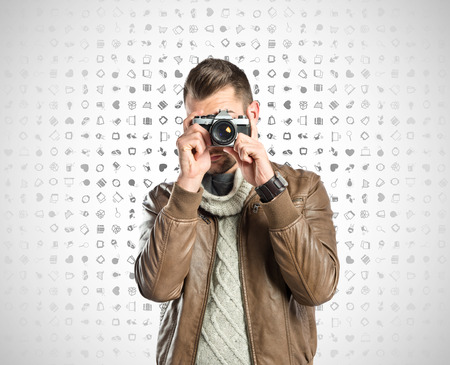 somebody: Man photographing somebody over icons background Stock Photo
