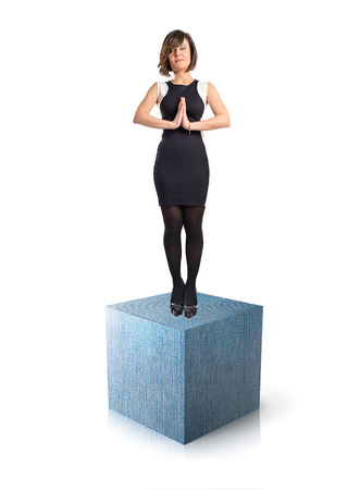 Zen woman on massive jean element over white background  photo