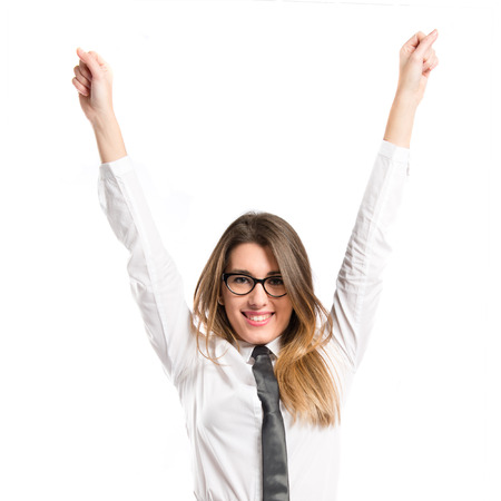 Young businesswoman winning on white background  photo