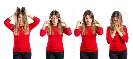 Cute girl covering her ears, and frustrated over isolated white background  photo