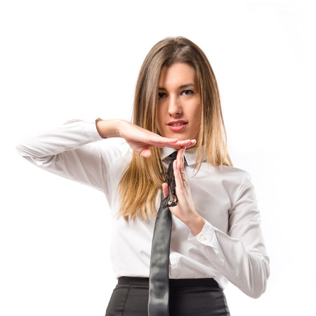 Young girl making time out gesture over white background  photo