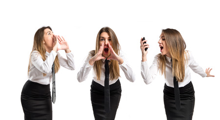 Young businesswoman shouting over isolated white background  photo