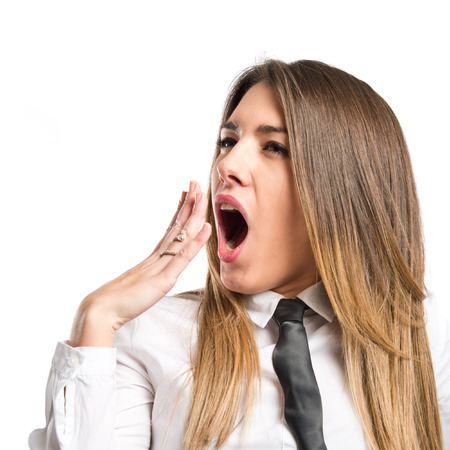 Young girl yawning over isolated white background  Stock Photo - 28401769