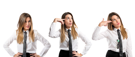 Businesswoman making a crazy gesture over white background