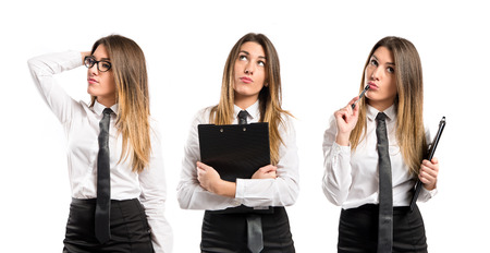 Cute businesswoman thinking an idea over isolated white background  photo