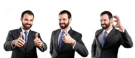 businessman making an OK gesture over isolated white background  photo