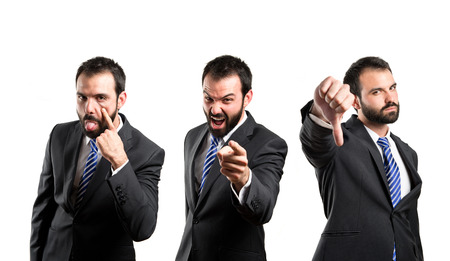 mockery: Young businessman making a mockery, a bad sign, and shouting