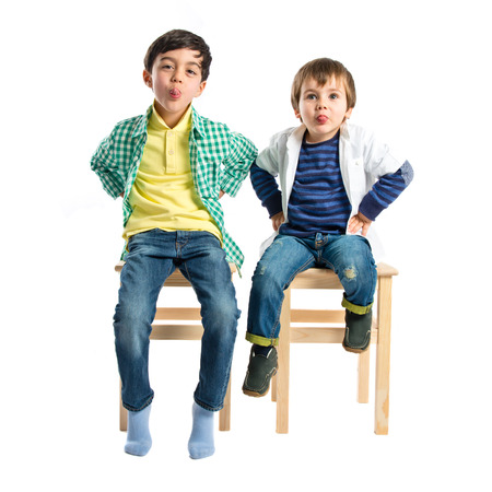 mockery: Boys making a mockery over isolated background  Stock Photo
