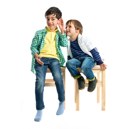Kids whispering over white background  photo