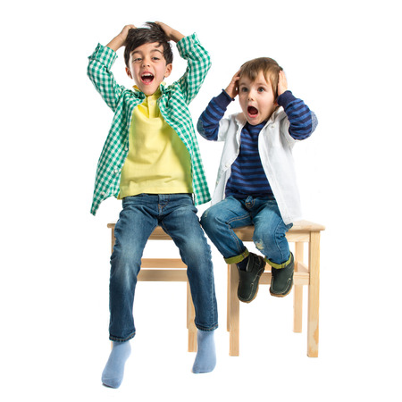 Kids frustrated over white background photo