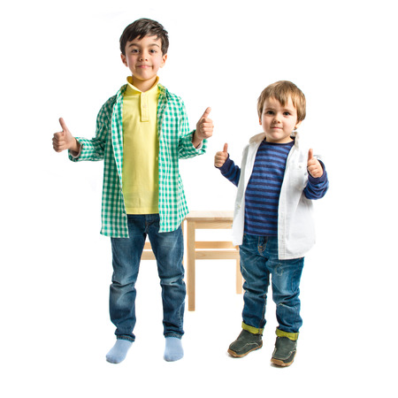 Boys making OK sign over white background  photo
