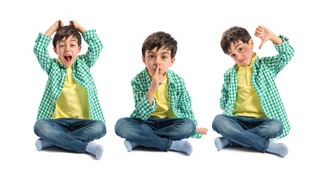 Kid doing silence gesture, bad sign and shouting photo