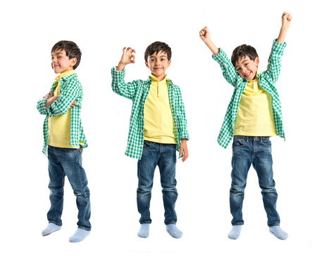 Boys making a victory sign on wooden chair over white background  photo
