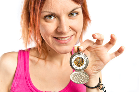girl with a wristwatch: Redhead girl holding a wristwatch over white