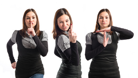 Young girl making silence gesture, horn gesture and time-out gesture  photo
