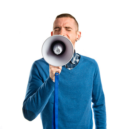 criticizes: Redhead man shouting by megaphone over white background