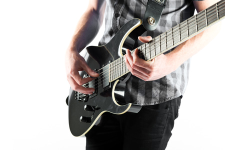 Young man playing guitar over white background photo