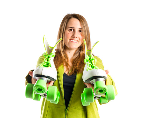 Girl with rollerskate over white background photo