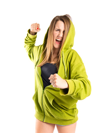 Girl giving punch over isolated white background photo