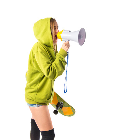 Young girl shouting over isolated white background photo