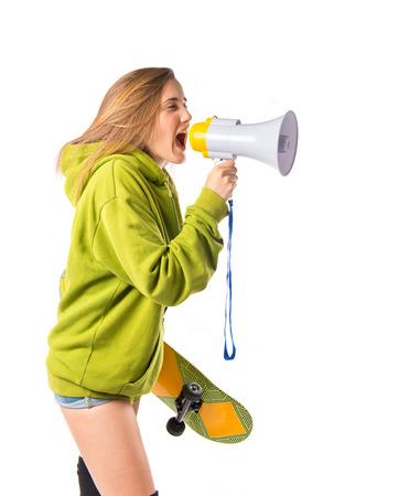 Girl shouting over isolated white background photo