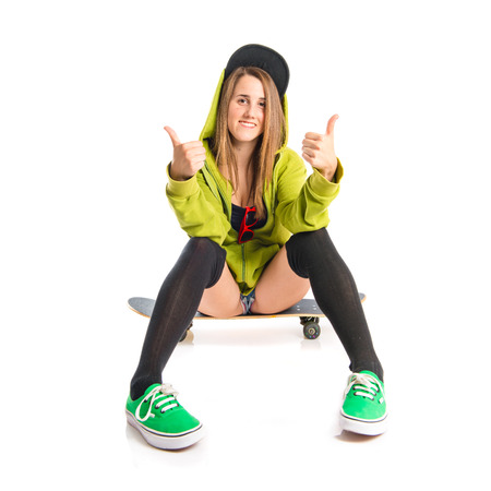 cool girl: Pretty young girl wearing urban style with skateboard