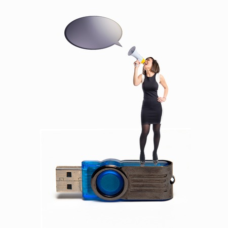 Woman shouting with a megaphone on pendrive photo