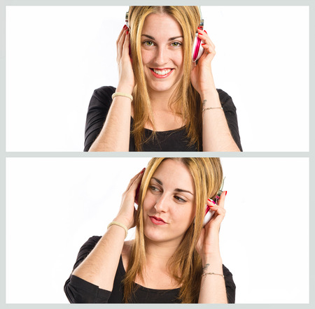 Young blonde girl listening music over white  photo