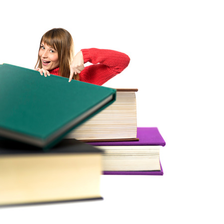 Girl pointing books over white  photo