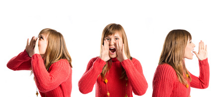 Young girl shouting over isolated white  photo