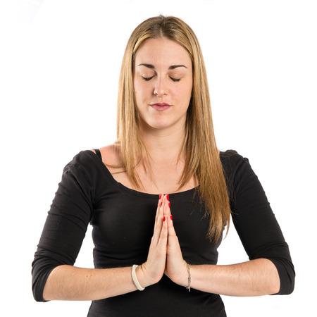 Girl in zen position over white