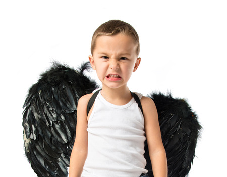 angry angel: Kid with black wings over white