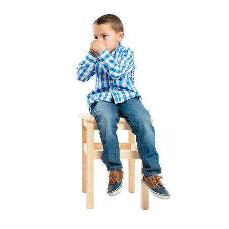 Kid making odor gesture over white  photo
