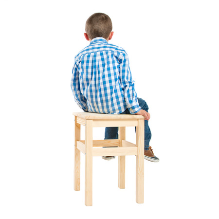 back kid on wooden chair over white background Stock Photo