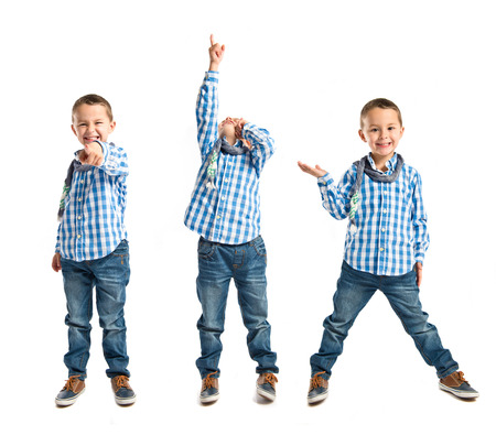 Kid pointing over isolated white   photo
