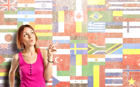 Young girl thinking over flags   photo
