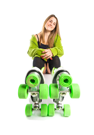 rollerblade: Blonde girl with rollerblade over white background