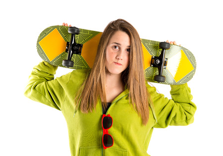 Blonde girl with skate over white background photo
