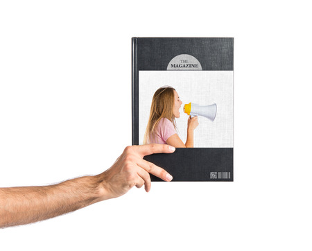 Blonde girl shouting with a megaphone printed on book photo