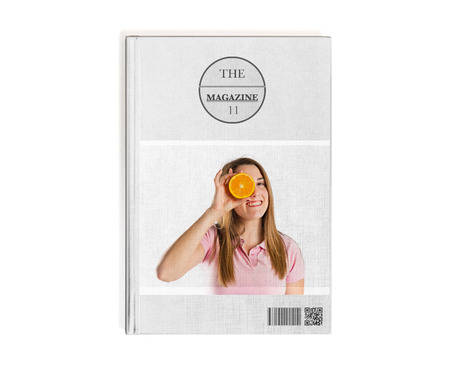 Young girl playing with orange printed on book photo
