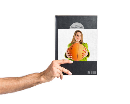 Young girl with basketball printed on book photo