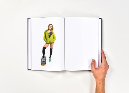 Pretty young girl wearing urban style printed on book photo