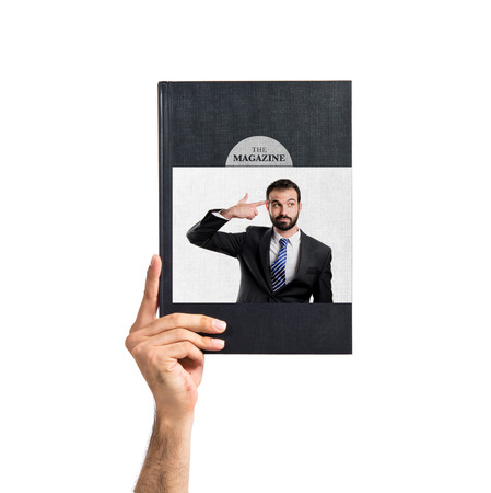 Young businessman committing suicide printed on book photo