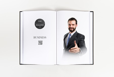 businessman making a deal printed on book photo