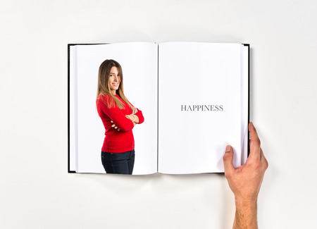 Young women with hers arms crossed printed on book photo